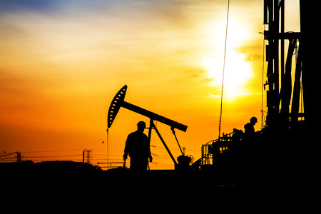 In the evening,oil field, the oil workers are working Stock Photo
