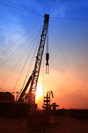 the silhouette of oilfield derrick
