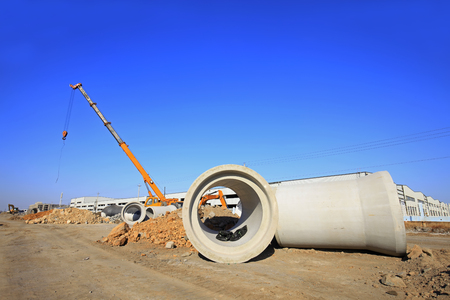 Cement pipe in the construction site Редакционное