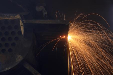 The workshop welder cuts metal