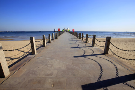 The seaside scenery and the seaside pier Stock Photo
