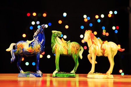 tri-coloured glazed pottery of the Tang Dynasty?Tang sancai glaze horses Editorial