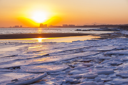 The sunset at the seaside in winter Stock Photo