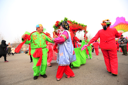 Fengnan County- February 26: Chinese traditional style yangko folk dance performance in the street, on February 26, 2017,Fengnan County, hebei Province, China