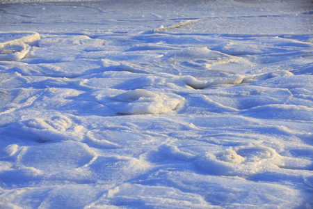 Ice and snow are on the beach