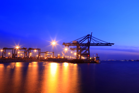 Freight dock of container crane at night Stock Photo