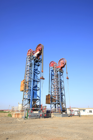 Oil field scene,Tower type pumping unit under the blue sky