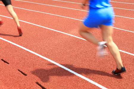Athletes running on the track