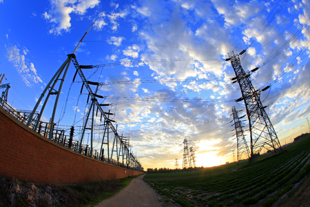 Substation in the evening, the silhouette of the power supply facilities Stock Photo