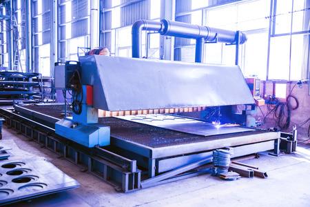 plasma torches cutting machine in mechanical shop Stock Photo