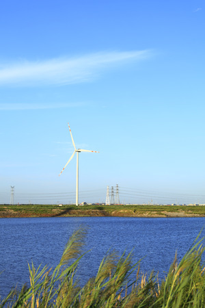 Wind turbines under blue skies and white clouds