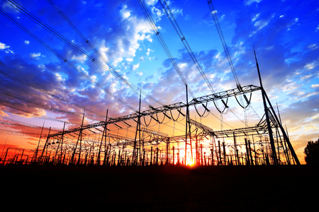 Substation in the evening, the silhouette of the power supply facilities Фото со стока