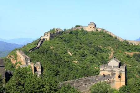 The Great Wall is under the blue sky and white clouds