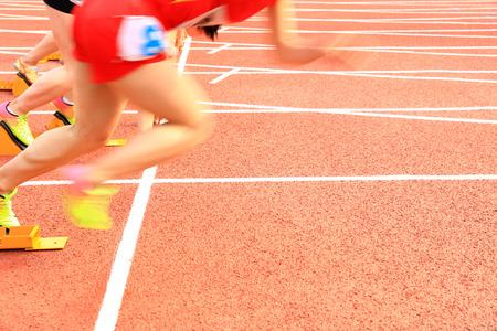 athlete sprint start at run track