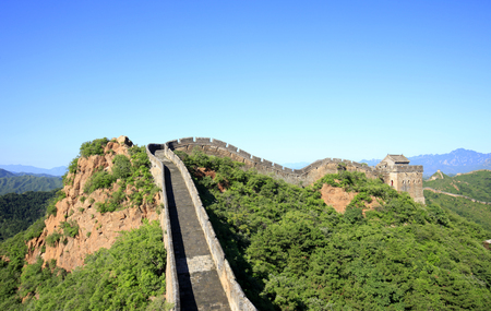 The Great Wall is in China. The Great Wall is under the blue sky and white clouds