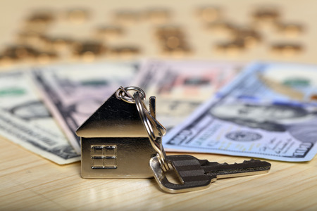 House model, the key and the dollar
