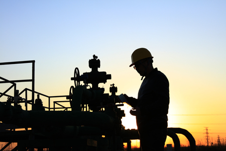 the oil worker  working in oil field Stock Photo