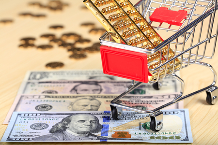 Gold abacus and the dollar Stock Photo