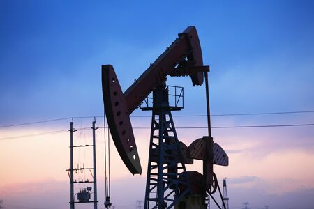 In the evening, the silhouette of the oil pump Stock Photo