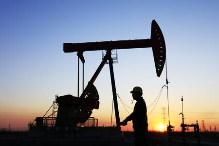 In the evening oil field, the oil workers are working