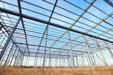 In the construction site, steel structure is under construction 写真素材 - 129444728