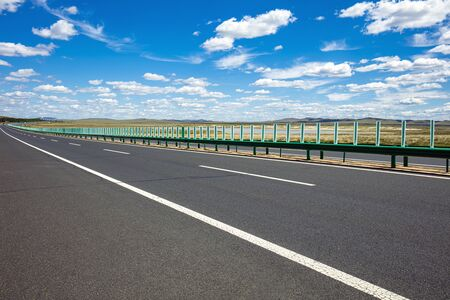 Highway, blue sky and white clouds Foto de archivo - 129880752