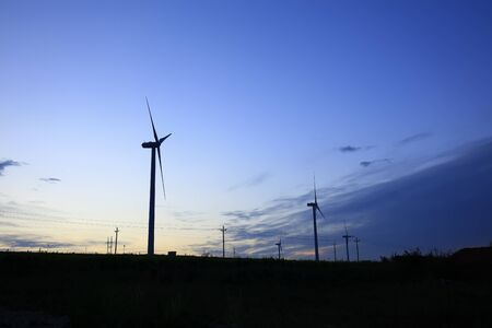 In the evening, the silhouette of wind turbines Stock Photo