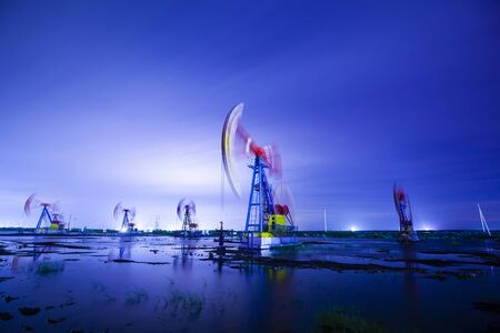 Oil pump at night, oil beam pumping unit at night Stock Photo