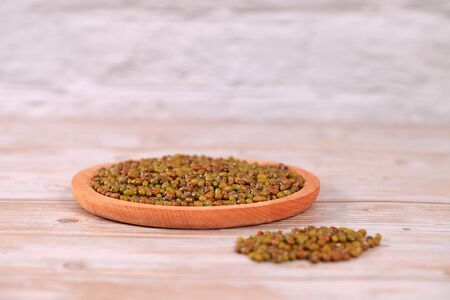 Mung beans on wooden table