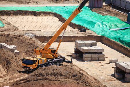 Mobile crane work on construction sites, Construction site