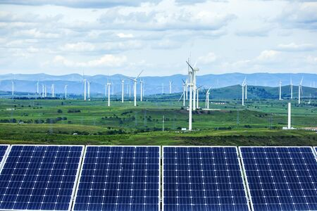 Solar photovoltaic panels and wind turbines. Energy concept
