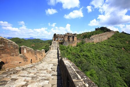 The Great Wall under the blue sky and white clouds, China. Фото со стока