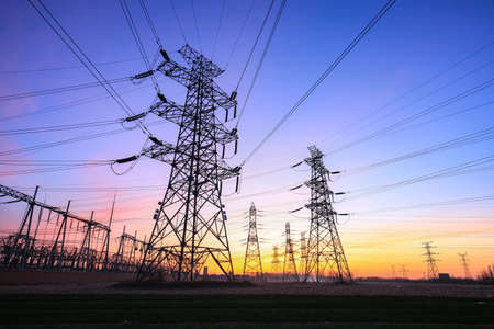 The power supply facilities of contour in the evening Banco de Imagens