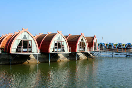 Wooden houses on the water, log cabins by the sea, places for tourists to rest