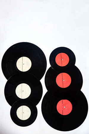 Vinyl records of different diameters on a white background Foto de archivo