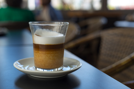foamed: A Latte Macchiato with its typical three colorful layers created by the foamed milk and the espresso coffee