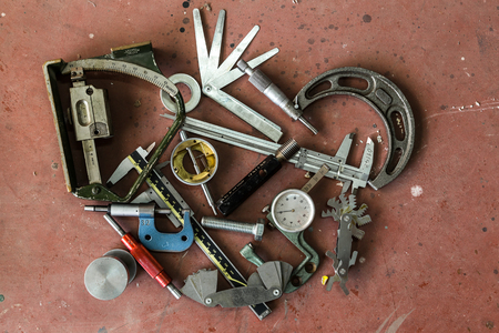 measuring instruments: Old mechanical measuring instruments and tools Stock Photo