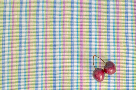 painterly: A pair of dark shining cherries on a colorful background, painterly