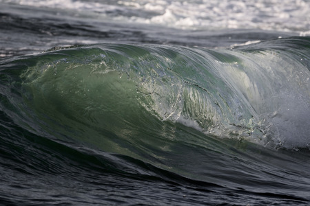 breaking in: Small shore waves breaking in late afternoon in Shavei-Zion beach Stock Photo