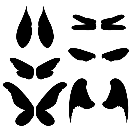 black wings: Vector illustration wings of different animals and insects. Isolated wings silhouetted against a white background.