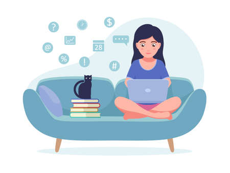 Girl sitting on the couch with a laptop