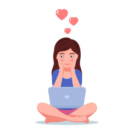 Girl in love sits on the floor with laptop