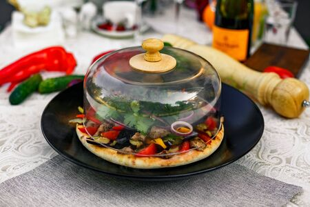 salad with meat greens and vegetables grilled on a wheat cake with smoke
