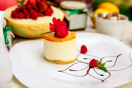 Raspberry Cheesecake with cheese tenderness and a light tinge of raspberry fruit