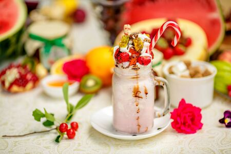 Crazy shake on top with a strawberry marmalade and candy and marmalade bears on a bright colored background