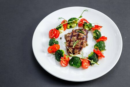 grilled meat with tomatoes and broccoli Stock Photo
