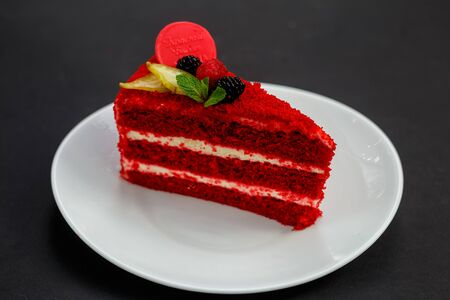 delicious red velvet cake with berries and mint, dessert
