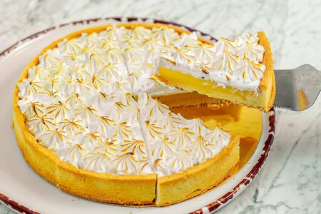 cream lemon cake on a marble table