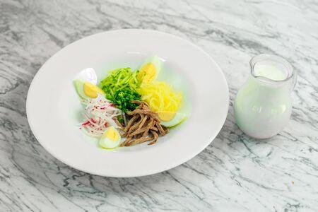 cooking Russian dishes okroshka, ingredients, beautiful presentation