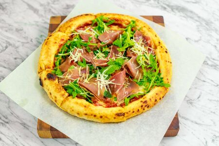 Italian pizza with mozzarella and basil